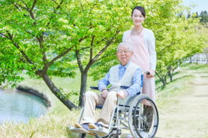 beautiful woman and elderly in a wheelchair